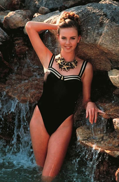 Miss Theron In Black Swimsuit