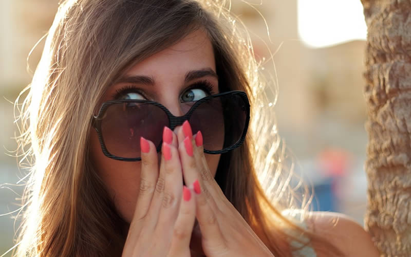 Woman hiding her nose