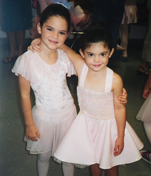 Young Kylie Jenner with her sister, Kendall.