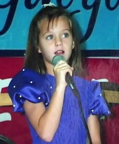 Young Katy Perry singing and performing